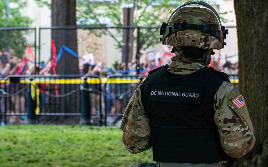 A District of Columbia National Guard soldier observes the Lafayette Park protest in Washington, D.C. on June 2, 2020.
