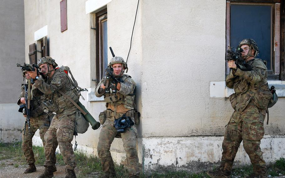 Paratroopers assigned to the 173rd Airborne Brigade tactically clear a town during Exercise Saber Junction 20 at the Hohenfels Training Area, Germany, Aug. 24, 2020.