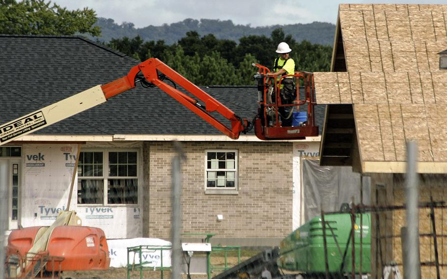 In an August, 2016 photo, contractors work on new housing units at Fort McCoy, Wis. The Army plans to invest $2.8 billion into base housing over the next five years, including 3,800 new homes and renovations for nearly 18,000 homes.