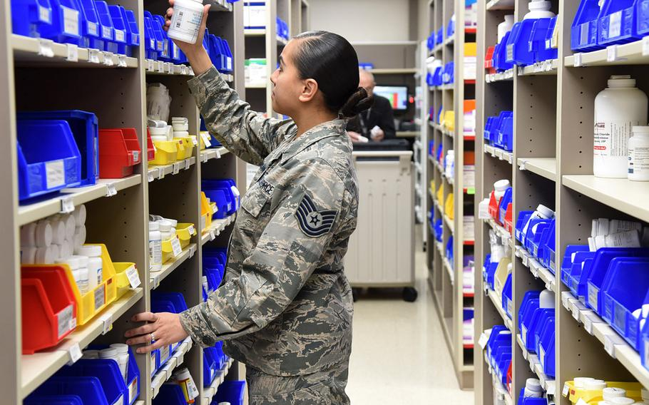 Tech. Sgt. Thesia Westmoreland, non-commissioned officer in charge of pharmacy operations with the 72nd Medical Support Squadron, pulls medications to fill prescriptions at the 72nd Medical Group Pharmacy at Tinker Air Force Base in Oklahoma.