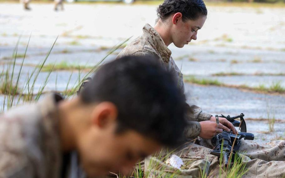 Recruits with Oscar Company, 4th Recruit Training Battalion, clean their rifles during the crucible on Marine Corps Recruit Depot Parris Island, S.C., Sept 24, 2020. The University of Pittsburgh is conducting a study to determine the best way for the Marine Corps to approach gender integration at its two boot camps, the service announced on Oct. 20, 2020.