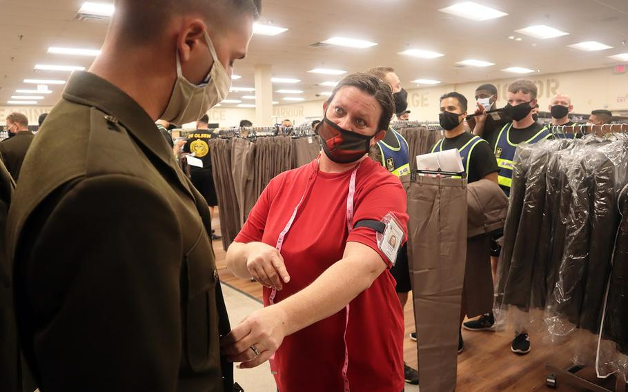 In a Sept. 3, 2020 photo, a drill sergeant gets fitted for an Army Green Service Uniform jacket by a Fort Sill Military Clothing Sales store shift manager. Some 200 new privates nearing the end of basic training at Fort Sill have recently been issued the new uniform, too.
