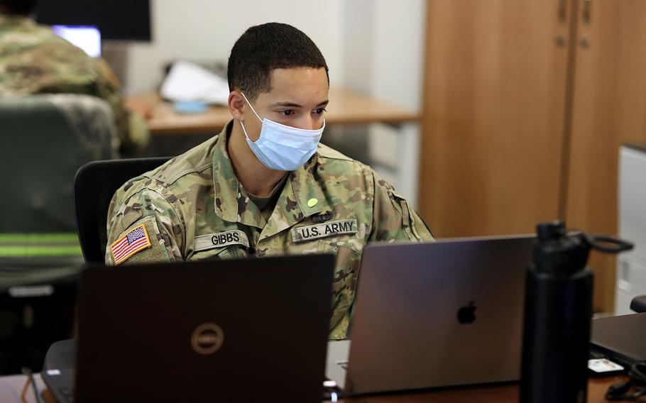 Sgt. Micheal Gibbs, a cybersecurity analyst with the North Carolina Army National Guard's 883rd Combat Engineer Company, monitors networks Nov. 2, 2020, while assisting the Cyber Security Response Force in their support of the State Board of Elections prior to the 2020 Presidential Election.