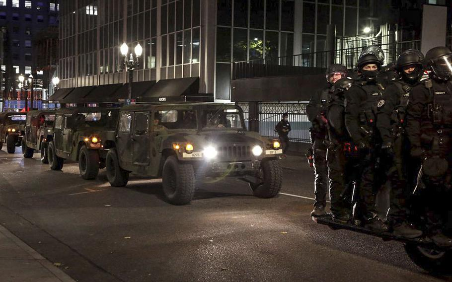 Oregon State Police and the Oregon National Guard patrol the streets in downtown Portland on Wednesday, Nov. 4, 2020.