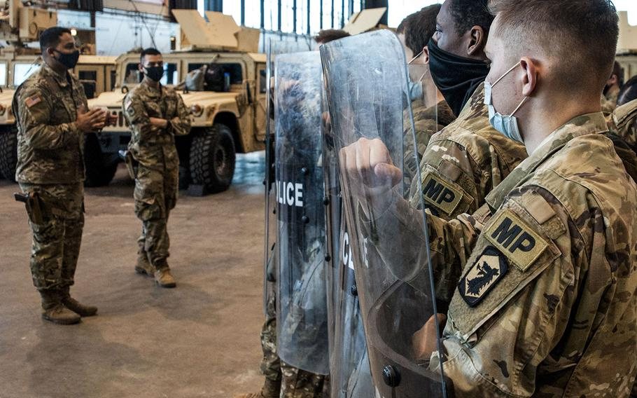 In a Nov. 2, 2020 photo, military police with the Illinois National Guard stage within the McCormick Place as part of Operation Civil Disturbance Response III. Nearly 400 soldiers and airmen were activated to stand ready to support civil authorities in the event of widespread unrest.