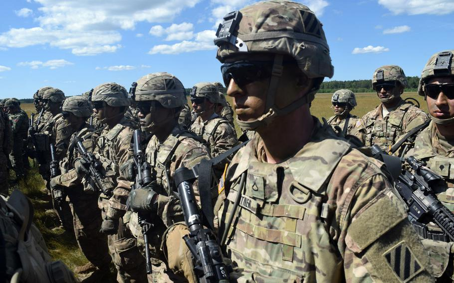 """Soldiers from the 3rd Infantry Division stand in formation during opening ceremonies of an exercise at Drawsko Pomorskie Training Area, Poland in 2016.The U.S. armed forces were rated """"marginal"""" in strength in an annual report by the conservative Heritage Foundation, despite America spending more on its military than the next 10 countries combined."""