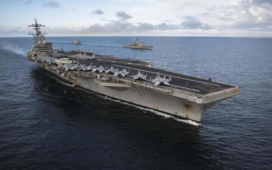 """The aircraft carrier USS George H.W. Bush, guided-missile cruiser USS Philippine Sea and the guided-missile destroyer USS Donald Cook operate in formation during a 2017 exercise in the Atlantic Ocean. The U.S. armed forces were rated """"marginal"""" in strength in an annual report by the conservative Heritage Foundation, despite America spending more on its military than the next 10 countries combined."""