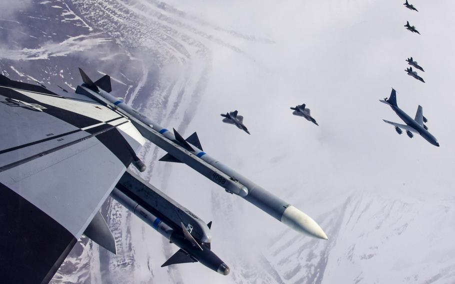 """U.S. Air Force F-35A Lightning II,  F-22 Raptor fifth-generation fighters, and F-16 Fighting Falcon fighter aircraft, as well as a KC-135 Stratotanker fly over the Joint Pacific Alaska Range Complex April 21, 2020. The U.S. armed forces were rated """"marginal"""" in strength in an annual report by the conservative Heritage Foundation, despite America spending more on its military than the next 10 countries combined."""