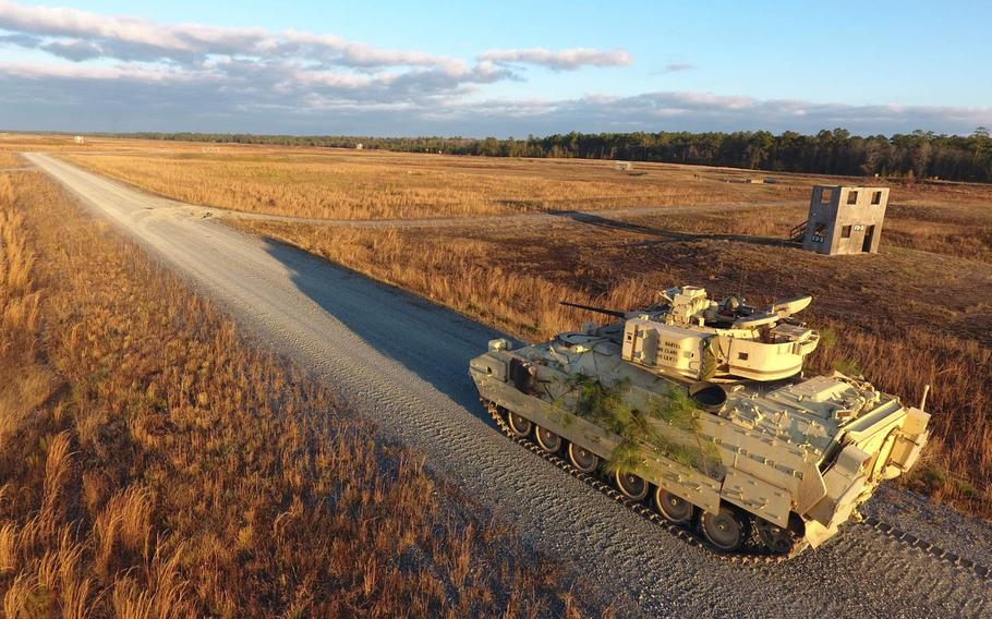 A Bradley Fighting Vehicle from the 1st Armored Brigade Combat Team, 3rd Infantry Division, conducts a gunnery exercise at Fort Stewart, Ga., Dec. 7, 2016. The Army is about to publish its new solicitation for an Optionally Manned Fighting Vehicle, which is expected to start replacing the Bradley in 2028.