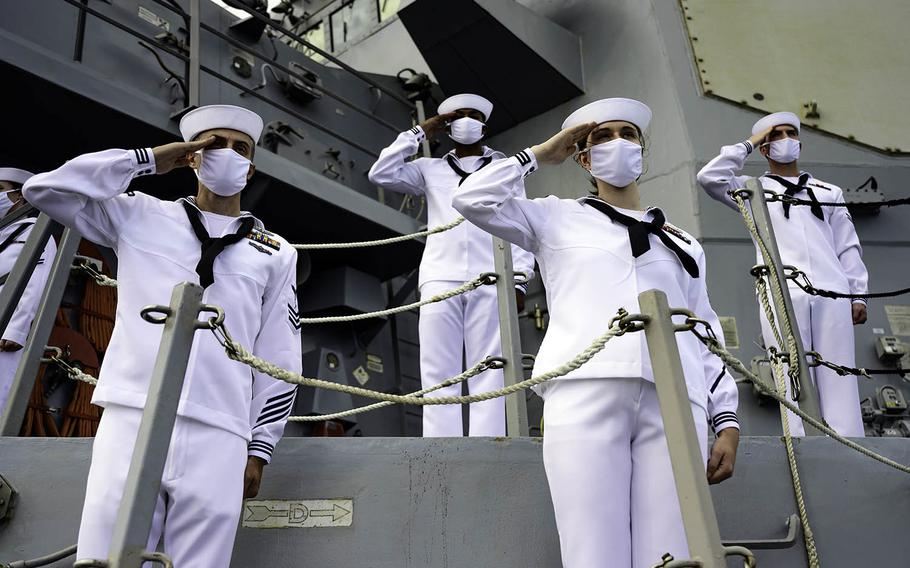 Sailors aboard the guided-missile destroyer USS Michael Murphy salute the Battleship Missouri Memorial and USS Arizona Memorial in Pearl Harbor, Hawaii, Sept. 2, 2020.