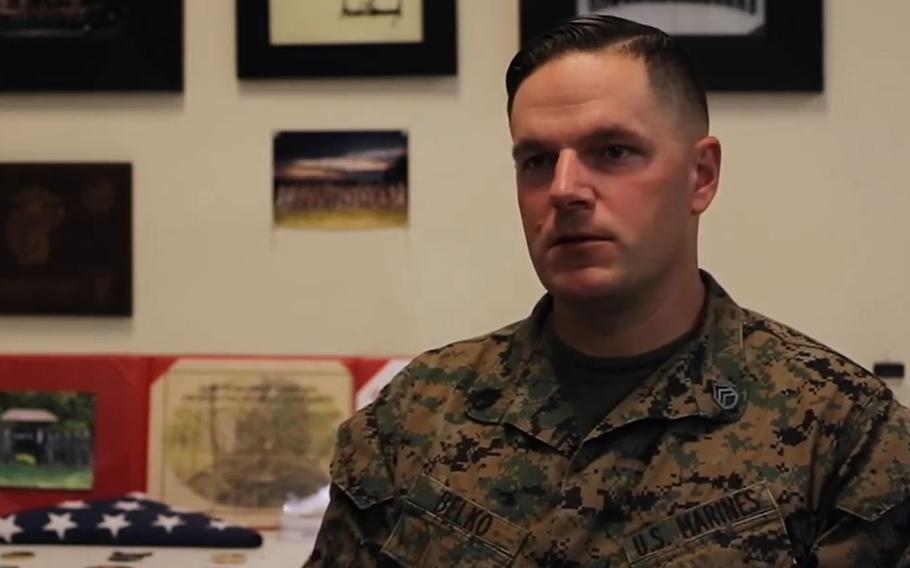 Staff Sgt. Jeffrey Belko, shown here in a video screenshot, was the guard duty officer at Marine Barracks Washington in Washington, D.C., when a woman was hit by a car and remained trapped underneath on Nov. 7, 2020. Belko and other Marines used jacks to help lift the car off the woman.