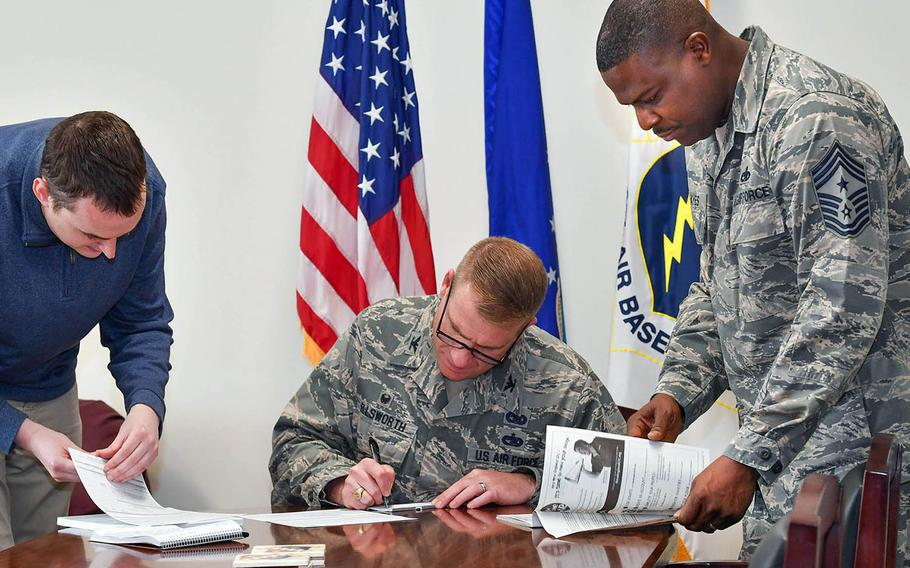 Service members complete their Combined Federal Campaign pledge forms at Hanscom Air Force Base, Mass., Oct. 17, 2020.