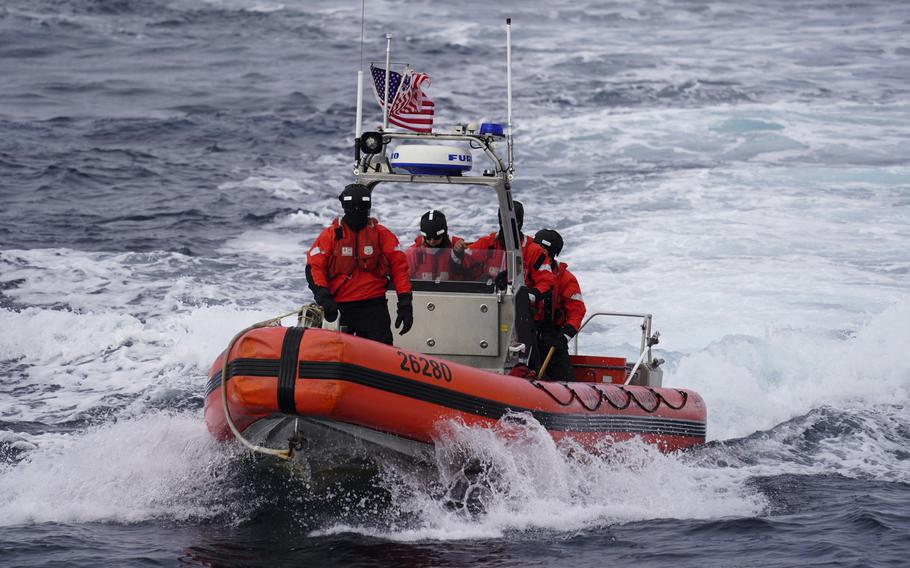 A U.S. Coast Guard cutter Tahoma boat crew participates in a search and rescue exercise with the HDMS Triton, a Danish navy vessel, Aug. 17, 2020, off Greenland.