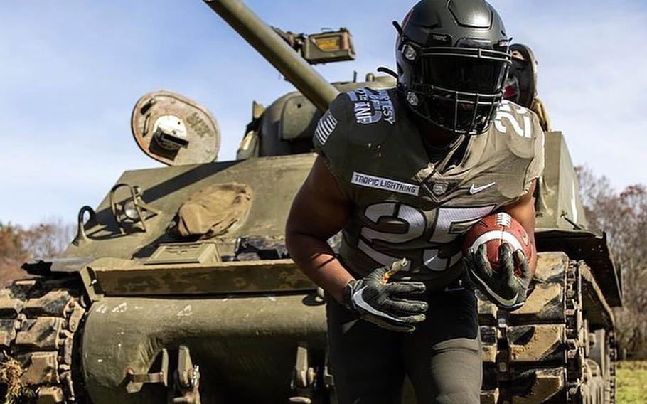 The 25th Infantry Division's Wolfhounds, whose soldiers defended a foothold on a Korean peninsula in 1950, are the inspiration for the Army's football uniforms for this year's Army-Navy game at West Point.