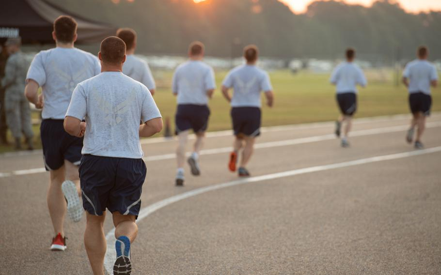 Officer Training School trainees run during an Air Force physical training test at Maxwell Air Force Base, Ala., Aug. 8, 2019. At least three Air Force bases in the U.S. have postponed the resumption of fitness testing until April amid the worsening pandemic.