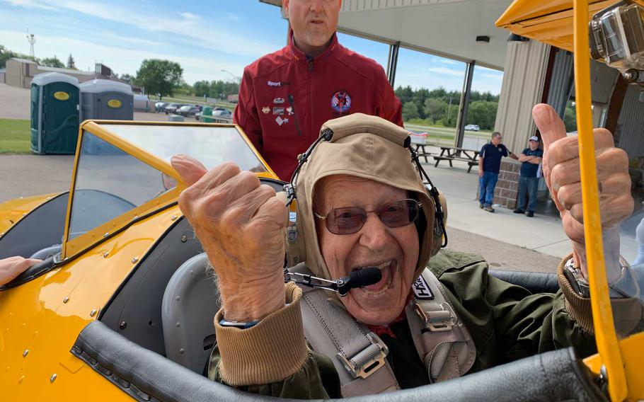 """Lewis """"Lew"""" Harned served in the American Field Service during World War II and the Air Force during the Korean War. Seen alongside Darryl Fisher, founder and president of Dream Flights, Harned, then 94 years old, received a flight with the nonprofit in Wisconsin in June 2019."""