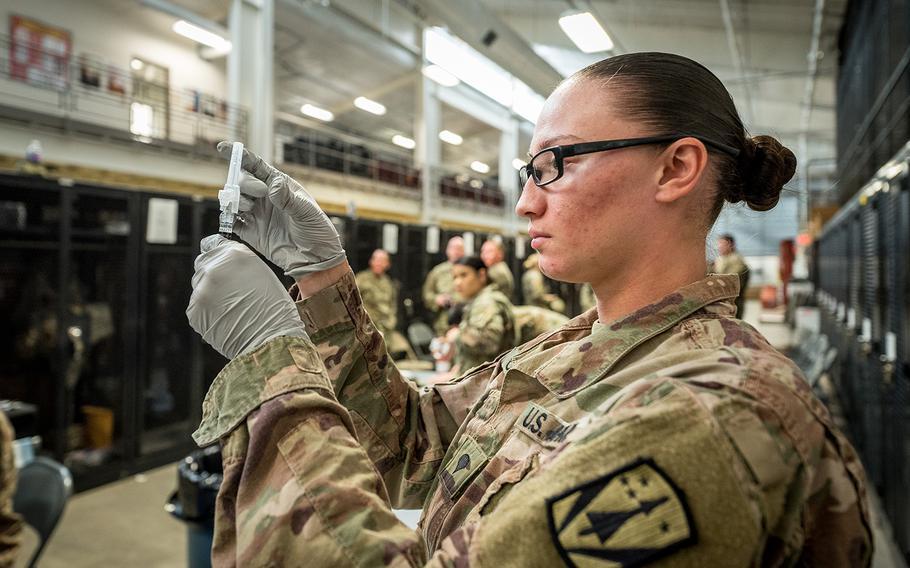 Spc. Selena M. Castillo prepares to administer a flu vaccination on Fort Sill, Okla., Nov. 15, 2019.  Spc. Castillo is a medic for 3rd Battalion, 2nd Air Defense Artillery Regiment, 31st Air Defense Artillery Brigade.