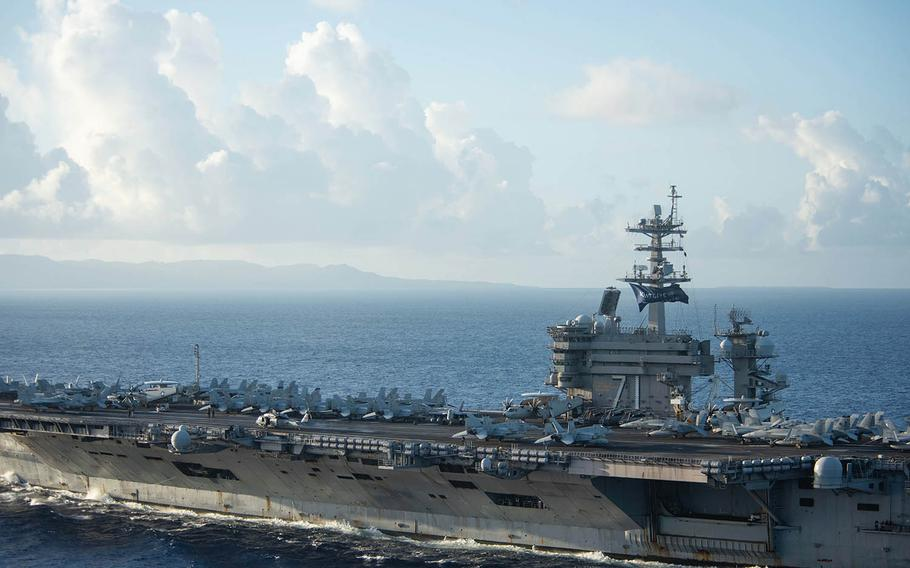 The aircraft carrier USS Theodore Roosevelt approaches Apra Harbor, Guam, June 3, 2020.
