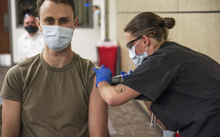 Airman 1st Class Kimber Bernau, 59th Medical Wing Family Emergency Clinic medical technician, administers the San Antonio Military Health System's first Pfizer COVID-19 vaccine shot to Maj. Andrew Gausepohl, Dec. 14, 2020, at Wilford Hall Ambulatory Surgical Center, Joint Base San Antonio-Lackland, Texas.