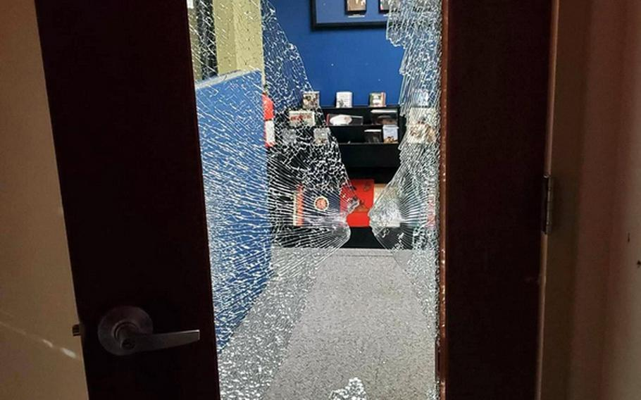 A photo posted on the unofficial Army Recruiter Times Facebook page show damage to the Armed Forces Recruiting Center in Greensboro, N.C., from a shooting Monday night. Police charged James Alexander Cooper, 36, with opening fire on the center. Military officials said he had been denied enlistment in the Army before the incident.