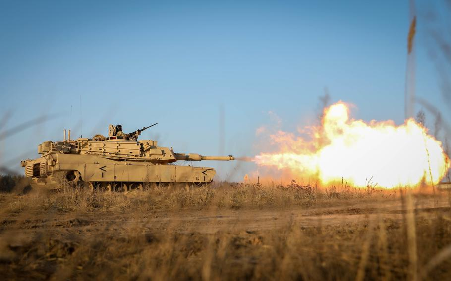 An M1 Abrams tank fires its main gun during a live fire exercise at Pabrade Training Area, Lithuania, Dec. 10, 2020. The Army has awarded a $4.6 billion contract to contractor General Dynamics Land Systems for a modernized version of the tank to be produced through 2028.