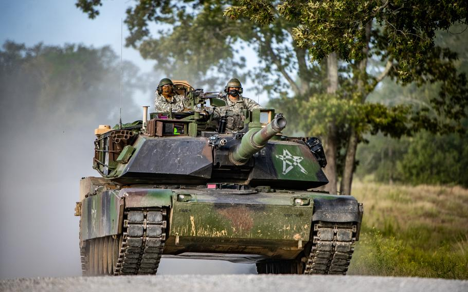 An M1 Abramstank, crewed by students of the Armor Basic Officer Leader Course, negotiates the terrain while training at Good Hope Maneuver Training Area, Fort Benning, Ga., Sept. 22, 2020. General Dynamics Land Systems has been awarded a $4.6 billion contract to produce a modernized version of the tank.