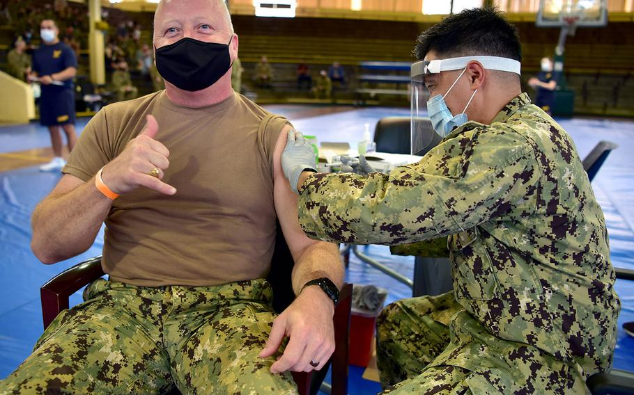 U.S. Pacific Fleet Fleet Master Chief James Honea receives the coronavirus vaccine at Joint Base Pearl Harbor-Hickam in Hawaii on Dec. 29, 2020, from Hospital Corpsman 2nd Class Philip Sayma, assigned to Navy Environmental and Preventative Unit 6. Naval Health Clinic was one of the facilities selected to receive the vaccine in a phased and coordinated strategy, prioritizing the vaccine for eligible personnel to protect their health, families, and communities.