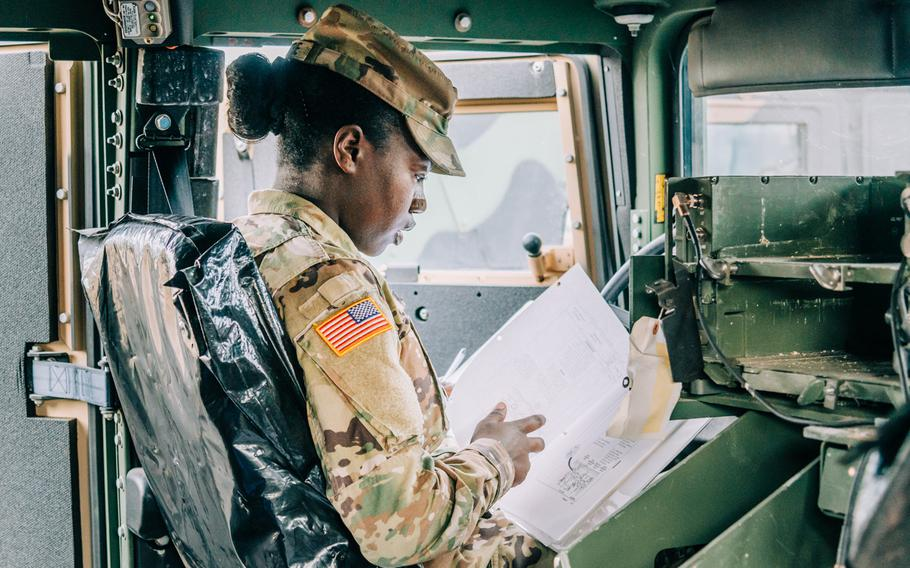 Pfc. Katelyn McCurrie, information technology specialist, Headquarters and Headquarters Battalion, U.S. Army Europe, performs motor pool inspection duties Aug. 10, 2020 at the Clay Kaserne motor pool in Wiesbaden, Germany.