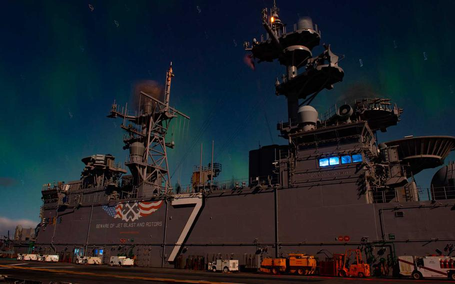 The Wasp-class amphibious assault ship USS Iwo Jima (LHD 7) passes under the Northern Lights while participating in exercise Trident Juncture 2018.  On Tuesday, Jan. 5, 2021, The U.S. Navy released its strategy on how the service plans to become more active in the Arctic as the region opens up to more economic and military competition from Russia and China.