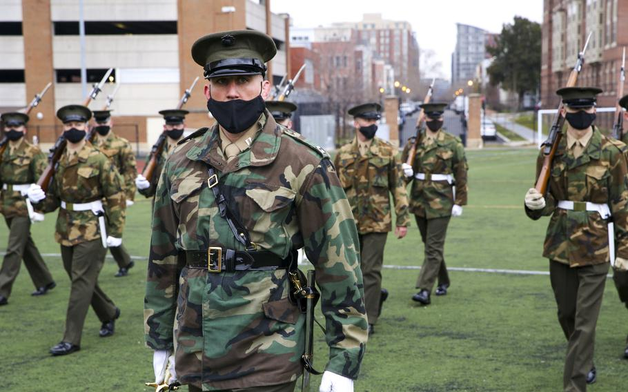 Marines with Marine Barracks Washington prepare for the next presidential inauguration, Washington, DC, Jan. 5, 2021. The Marines wear an unusual combination of a Vietnamese era field jacket in woodland camouflage with their khaki green service uniforms and olive green.