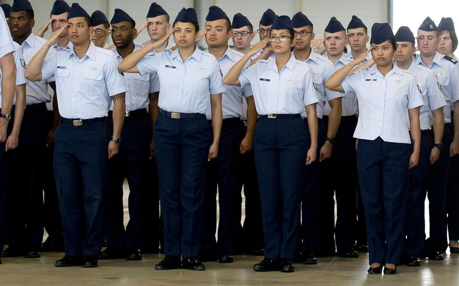 Airmen salute during a ceremony at Ramstein Air Base, Germany. The Air Force has directed commanders to begin collecting airmen's ranks, age, gender, race and ethnicity when meting out discipline such as letters of reprimand to determine if discipline is being meted out impartially, it announced in January 2021.
