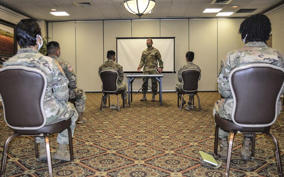 Sgt. Maj. of the Army Michael Grinston meets with junior enlisted soldiers at Fort Hood, Texas, to discuss efforts to improve the base's command climate and culture after an investigation released identified leadership failures and systemic problems.