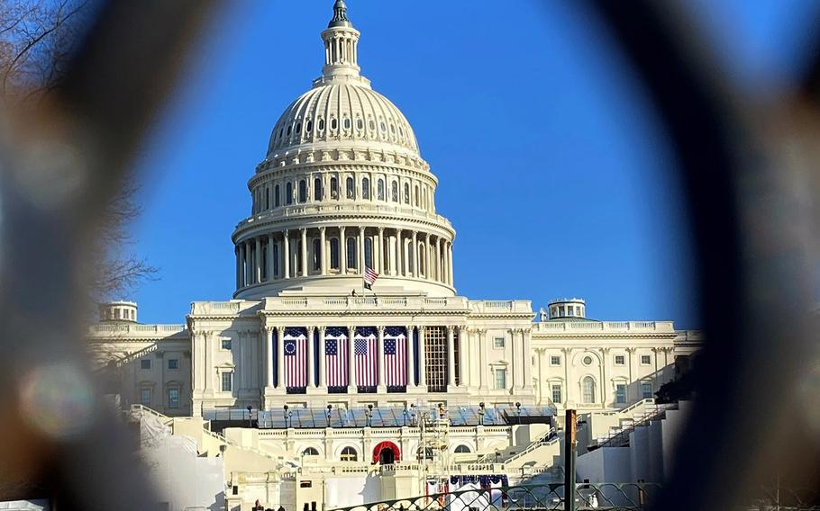 The U.S. Capitol is seen through a security fence on Jan. 12, 2021.