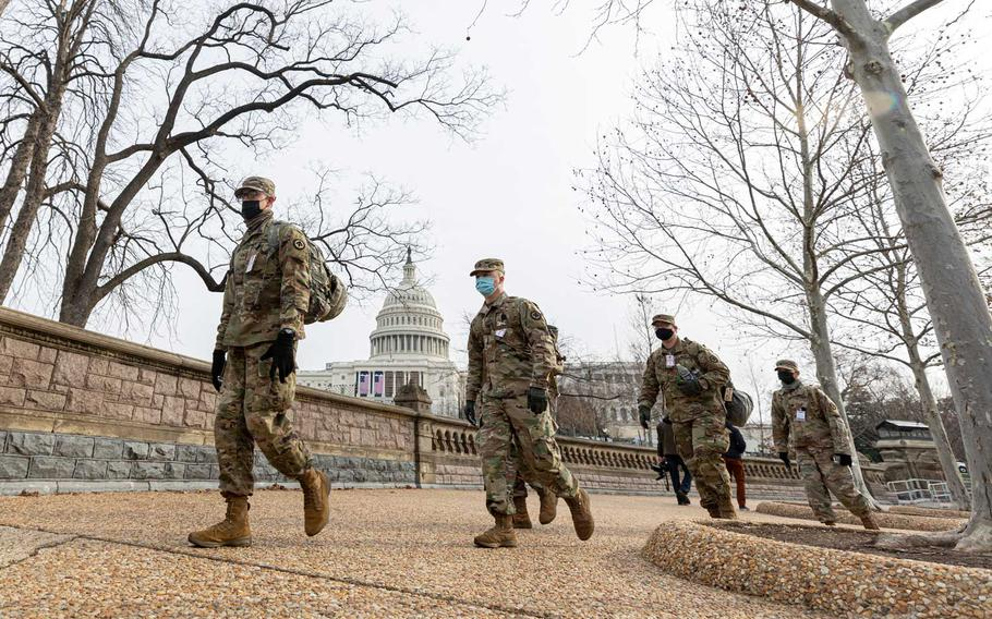 """U.S. Soldiers with the New Jersey National Guard patrol the area near the Capitol building in Washington, D.C., Jan 11, 2021. A memo, sent to the entire military and signed by all eight members of Joint Chiefs of Staff reiterates to the force that the U.S. military will obey lawful orders from civilian leadership and """"remains fully committed"""" to protecting and defending the Constitution."""