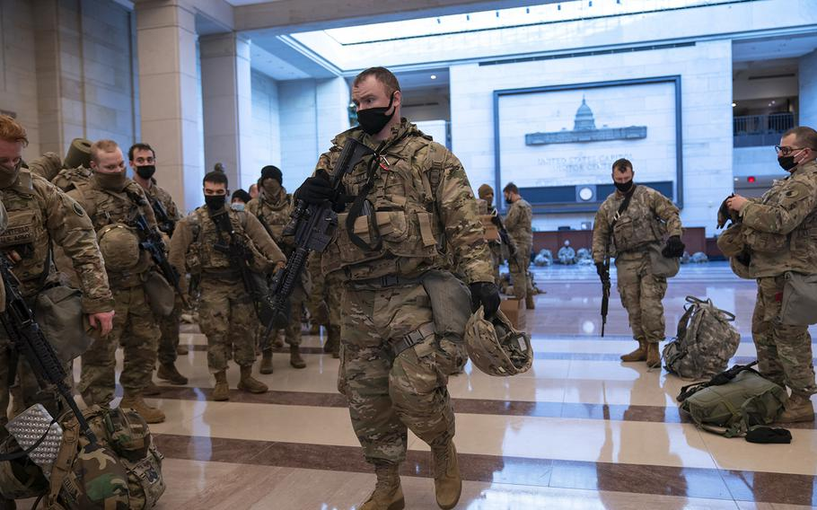 Hundreds of National Guard troops are stationed inside the Capitol Visitor Center to reinforce security at the Capitol in Washington, Wednesday, Jan. 13, 2021.