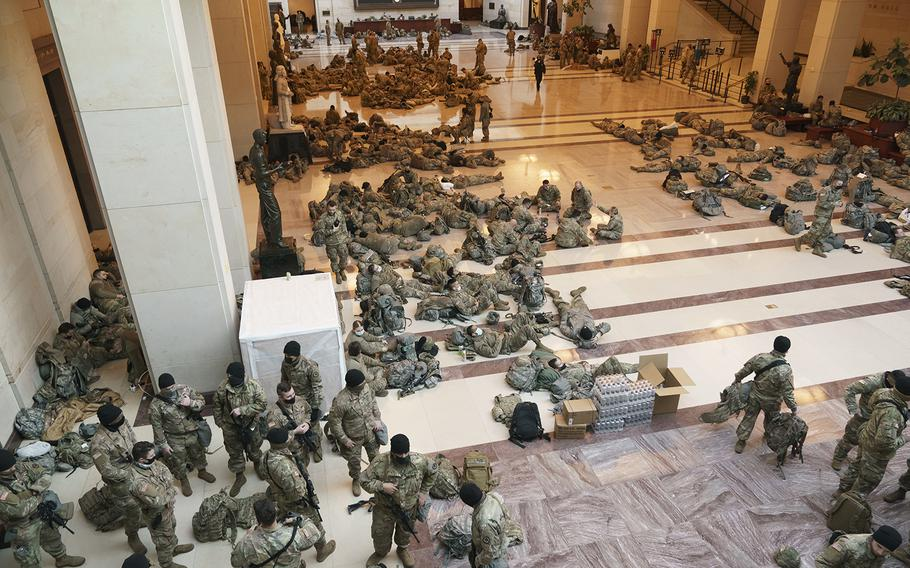 Hundreds of National Guard troops wait inside the Capitol Visitor Center to reinforce security at the Capitol in Washington, Wednesday, Jan. 13, 2021.