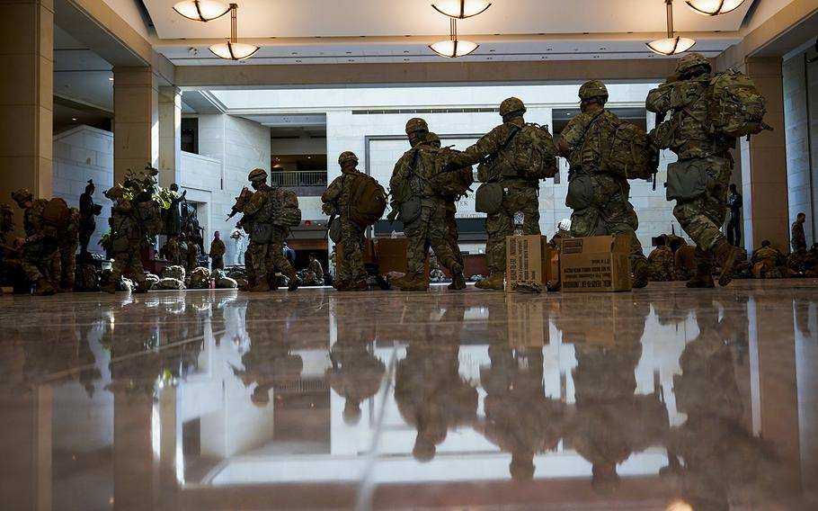 Troops move inside the Capitol Visitor Center to reinforce security at the Capitol in Washington, Wednesday, Jan. 13, 2021.