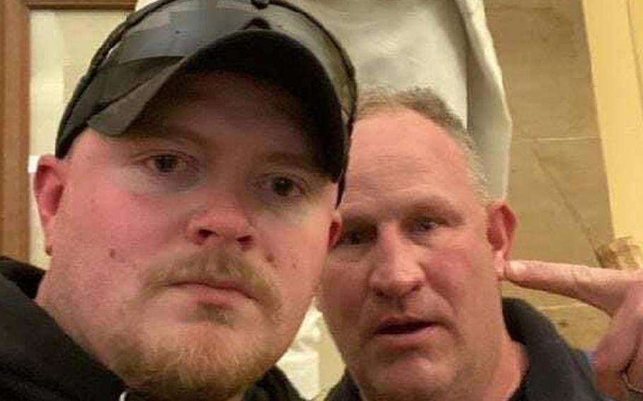 Jacob Fracker, left, a corporal in the Virginia National Guard, was arrested and charged Wednesday with one count of knowingly entering or remaining in any restricted building or grounds without lawful authority and one count of violent entry and disorderly conduct on Capitol grounds.