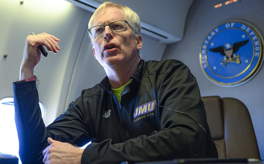 Acting Defense Secretary Chris Miller speaks to reporters on a government aircraft en route to Joint Base Andrews, Md., Jan. 14, 2021.