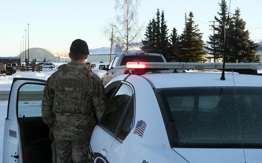 A member of security forces at Joint Base Elmendorf-Richardson, Alaska, simulates pulling over an alcohol-impaired driver, Jan. 15, 2019.