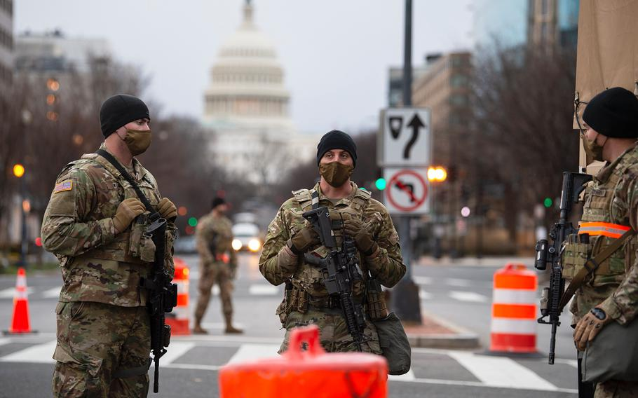 Members of the Pennsylvania National Guard's 2nd Battalion, 112th Infantry Regiment help provide security at a check point on New Jersey Ave. on the North side of the U.S. Capitol in Washington D.C., on Saturday, Jan. 16, 2021.
