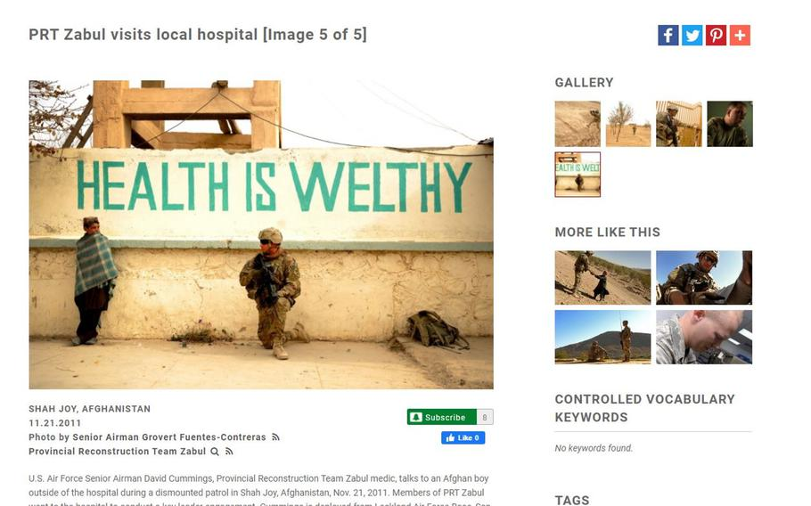 A screenshot of the U.S. military's official photo website, DVIDShub.net, showing a hospital in Shah Joy, Afghanistan. The photo is one of many free military photos being sold as posters or prints at various online sites.