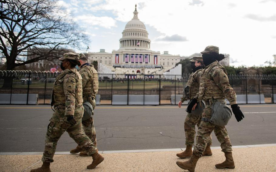 U.S. Soldiers with the District of Columbia National Guard, patrol around the Capitol during the Presidential Inauguration, Washington, D.C., Jan. 20, 2021.