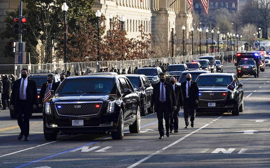 The Presidential motorcade drives through Washington, D.C., during Inauguration Day ceremonies Wednesday, Jan. 20, 2021.