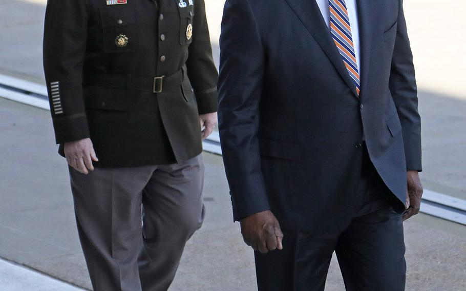 Defense Secretary Lloyd Austin walks up to the Pentagon accompanied by Army Gen. Mark Milley, chairman of the Joint Chiefs of Staff, shortly after being confirmed by the Senate Jan. 22, 2021. He was sworn in as the 28th defense secretary shortly afterward.(Photo by )