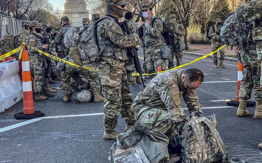 In a January 19, 2020 photo, National Guard troops in Washington, D.C. change shifts.