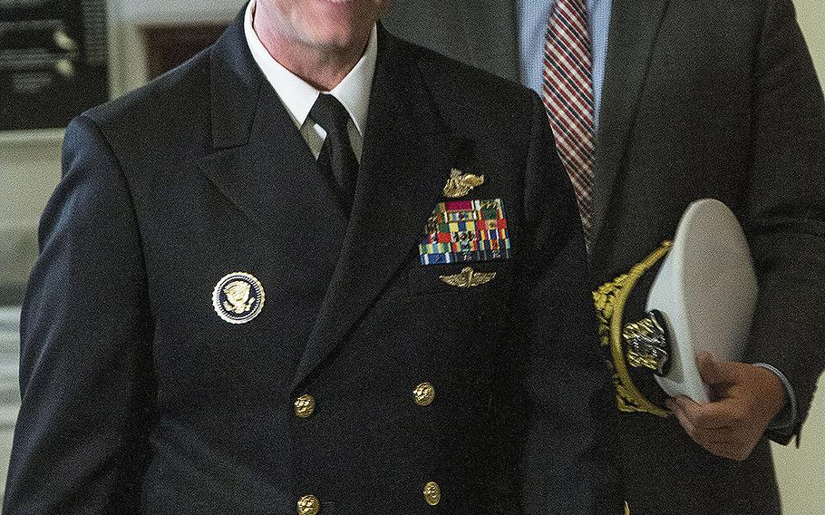 Rear Adm. Ronny Jackson, President Donald Trump's nominee to succeed David Shulkin as Secretary of Veterans Affairs, arrives for a meeting with Senate Veterans' Affairs Committee Chairman Johnny Isakson, R-Ga., on April 17, 2018.