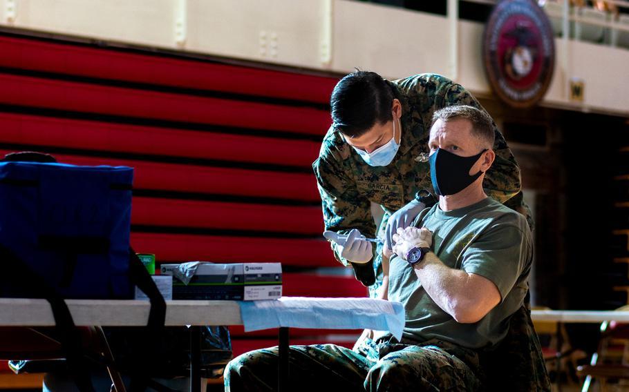 U.S. Marine Corps Col. George Markert, Chief of Staff of 2nd Marine Logistics Group, receives the Pfizer-BioNTech COVID-19 vaccine on Camp Lejeune, North Carolina, January 28, 2021.