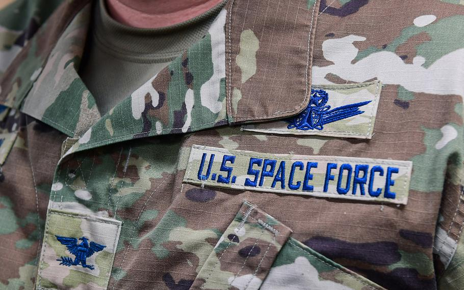 Col. Richard Bourquin, Space Delta 4 commander, poses for a detailed photo of his new U.S. Space Force patches after commissioning into the USSF in the DEL 4 conference room on Buckley Air Force Base, Colo., Jan. 5, 2021.