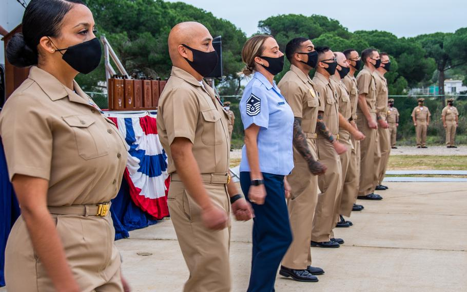 Service members selected for promotion to chief petty officer arrive in formation during a promotion ceremony at Naval Station Rota, Spain, Jan. 29, 2021.